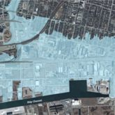 Blue shading from the western boundary of the port lands to just east of Leslie and north of Front Street